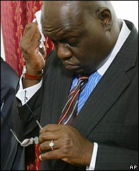 John Githongo, Kenya's former top anti-corruption official, wiping his forehead during a anti-corruption meeting  in 2004
