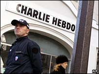A French policeman stands on guard outside the office of Charlie Hebdo newspaper
