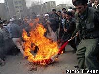 Afghan protesters in Kabul burn a Danish flag