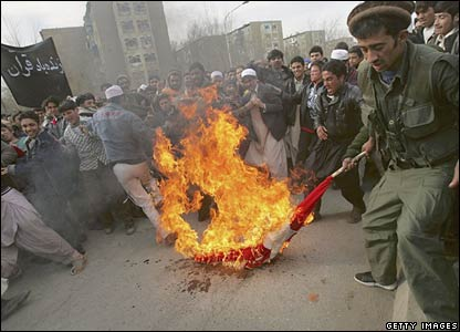 Afghan protesters burn a Danish flag in Kabul