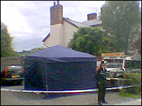Police at the scene at Mr Dowson's home