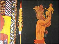 Painting of baby Jesus held aloft by a bearded tribesman in Nguiu church