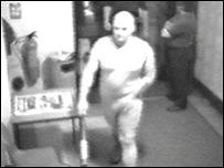 Michael Carroll armed with a baseball bat