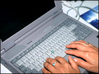 Hands at a laptop keyboard.  Image: BBC