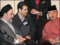 Malaysian Prime Minister Abdullah Badawi listens to Mr Khatami via an interpreter