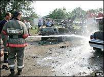 Chechen firemen extinguish the wreckage of the exploded vehicle