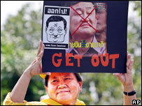 Protester holding an anti-Thaksin banner, 11 Feb