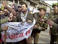 Policemen detain Jammu Kashmir Liberation Front or JKLF chairman Javed Mir