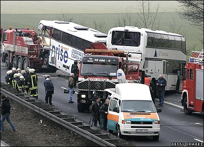 Emergency services view the wrecked buses at the crash scene