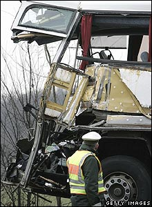 Policeman examines the wreckage following Saturday's crash