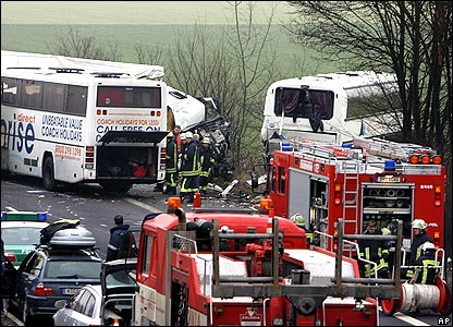 Rescue workers at the crash site on the A4 motorway near Kerpen, Germany