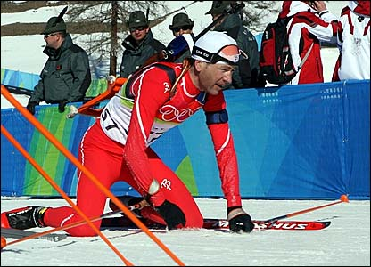 Ole Einar Bjoerndalen collapses after finishing second