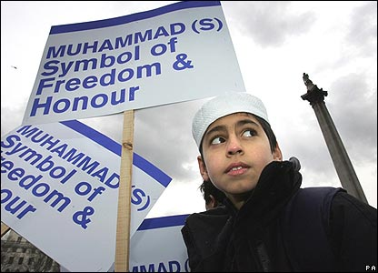 A Muslim attending the rally, carrying a banner expressing the views of many