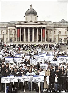 Campaigners stand at the foot of the steps at Trafalgar Square, where the rally took place