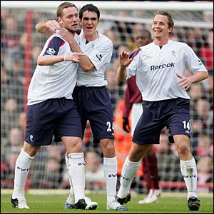 Kevin Nolan is congratulated by Joey O'Brien and Kevin Davies