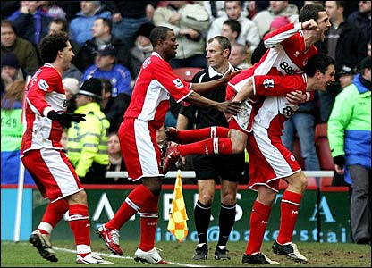 Stewart Downing is mobbed by his team-mates