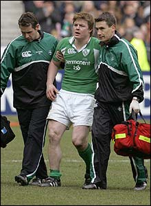 Brian O'Driscoll is helped off a few minutes from the final whistle