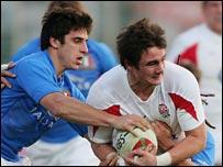 Italy's Ludovico Nitoglia tackles England's Harry Ellis