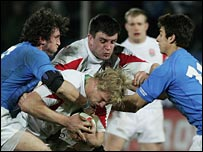 Mauro Bergamasco and Ludovico Nitoglia tackle Lewis Moody
