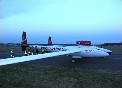 Emergency crews check the plane