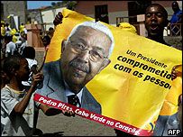 Pires supporters carry his posters through the streets of the capital Praia