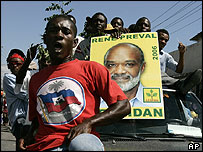 Supporters of Rene Preval march in Port-au-Prince, Haiti