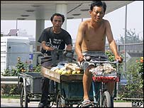 Chinese men on bicycles