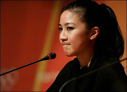 Michelle Kwan looks emotional announces her withdrawal from the Olympics