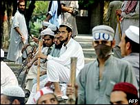 Students outside the Red Mosque seminary after a raid in Islamabad
