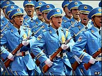 Chinese soldiers march outside of Beijing's Great Hall of the people in the Chinese capital Friday, July 1, 2005.