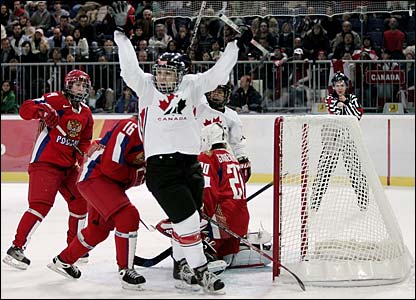 Canada's Meghan Agosta celebrates scoring