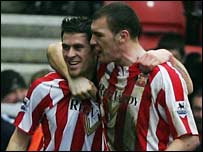 Daryl Murphy is congratulated by Kevin Kyle