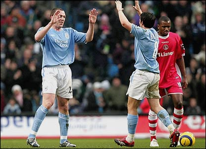 Richard Dunne and Joey Barton celebrate