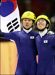 South Korea's Ahn Hyun-Soo (left) celebrates his victory with compatriot Lee Ho-Suk