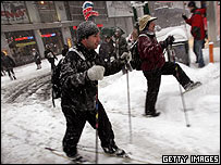 New Yorkers on skies make their way through the snow in Time Square