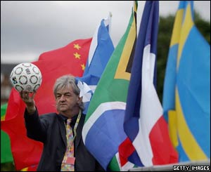 Mel Young with flags and ball