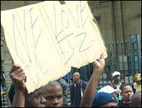 People with Jacob Zuma poster