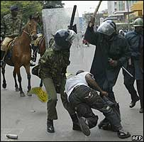 Man surrounded by Kenyan police