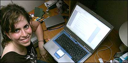 Image of a podcaster in front of her laptop