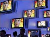 Wall of TV screens, AFP