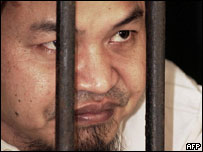 Irun Hidayat looks out from his detention house before his trial in Jakarta, 21 July 2005.
