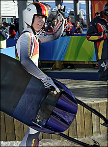 Sylke Otto acknowledges the crowd at the midway point of the women's individual luge competition