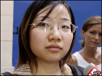 Chinese student Li-Li Whuang faces the press, 20 June 2005 as she leaves the Versailles jailhouse.