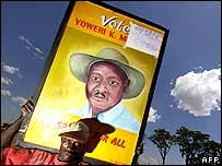 A supporter of President Museveni tries to sell a portrait