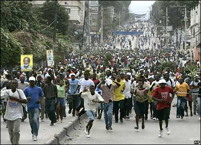 Protesters march in support of Rene Preval in Haiti's capital, Port-au-Prince