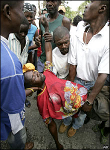 An injured protester is helped in Port-au-Prince, Haiti