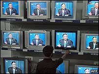 Televisions showing President Musharraf