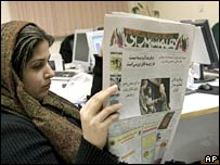 An Iranian woman reads the Hamshahri newspaper