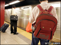 Man wears a backpack inside Cortlandt Street subway station