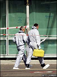 Forensic police officers are seen at University College Hospital